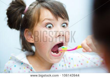 Girl Brushes Her Teeth