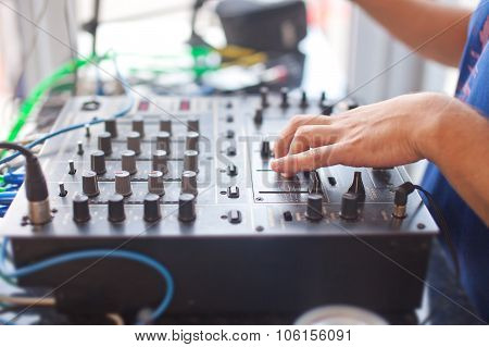 DJ mixing music on console at the night club. poster