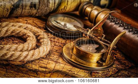 Travel geography navigation concept background - panorama of old vintage retro compass with sundial, spyglass and rope on ancient world map poster