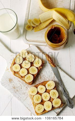 Sweet food. Delicious peanut butter toast with banana