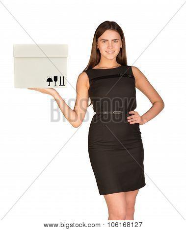 Businesslady holding white box