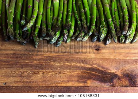 Background. Fresh Asparagus On Wooden Table