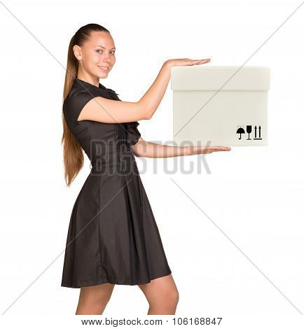 Smiling businesslady holding white box