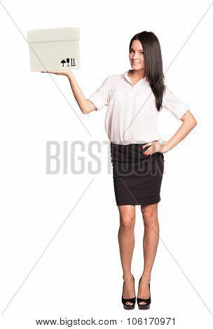 Lady holding box and looking at camera
