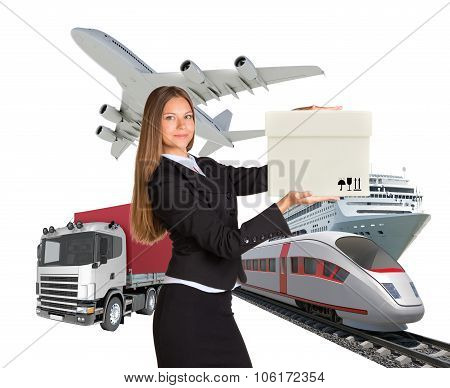 Lady holding box and looking at camera on whhite