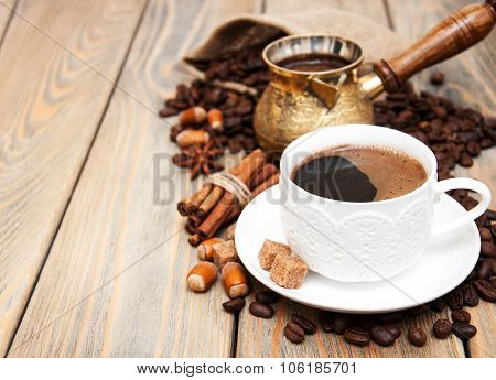 coffee cup metal turk and coffee beans on a wooden background poster