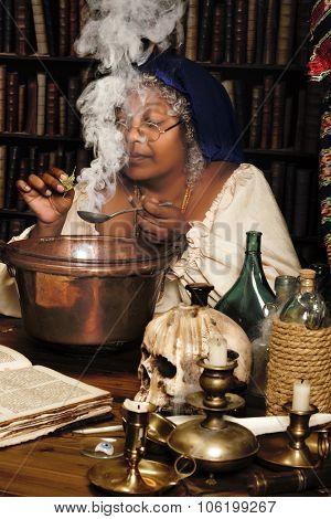 Halloween wizard adding herbs to a smoking cauldron