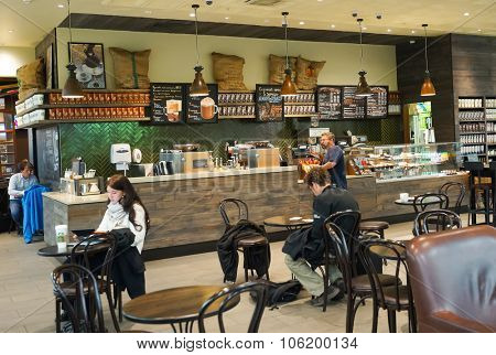 MOSCOW, RUSSIA - SEPTEMBER 24, 2014: Starbucks cafe interior in Sheremetyevo airport. Starbucks Corporation is an American global coffee company and coffeehouse chain based in Seattle, Washington