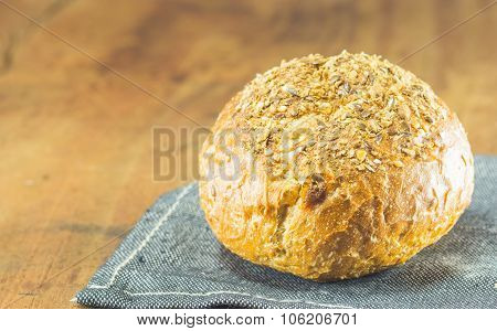 the fresh bread on the wood background warm toning selective focus poster