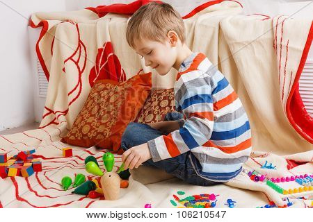 Little boy playing with wooden toys