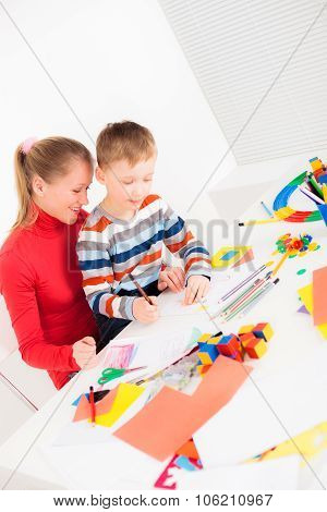 Mother and child drawing picture