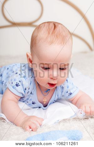 Little boy laying on bed