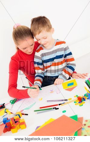 Son and his mother drawing picture