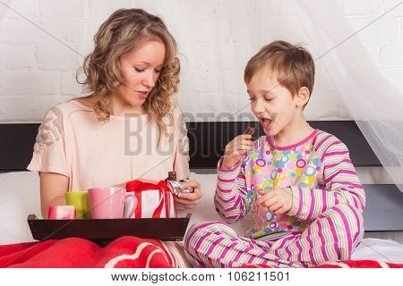 Mother and her son having breakfast