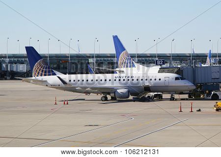 United Express Embraer plane on tarmac at O'Hare International Airport in Chicago