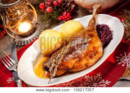 Crusty Christmas goose leg with braised red cabbage and dumplings poster