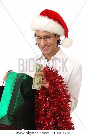 Man Peering At Christmas Gift