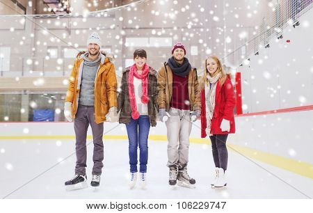 people, friendship, sport and leisure concept - happy friends on skating rink poster