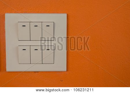 Dimmer Switch And Light Switch On Switchboard.over Wall