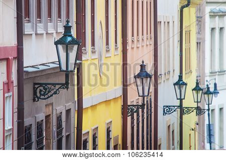 Colored facades with street lamps in Prague