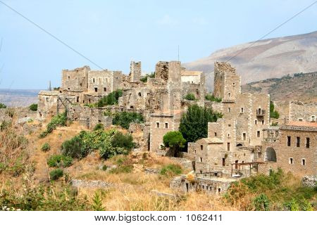 historic village with mani towers on hill poster