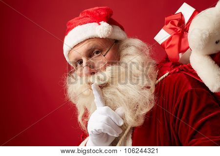 Santa carrying sack with xmas gifts