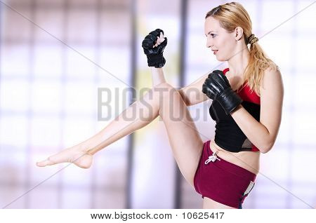 Woman Fighter Knee Kick.