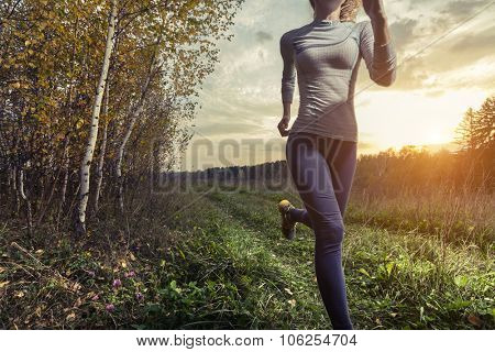 Lady running in the autumn forest