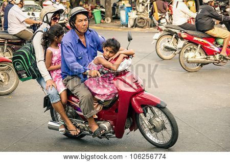 Ho Chi Minh City, Vietnam - February 6, 2013: Full Family Driving A Scooter In The City Traffic. The