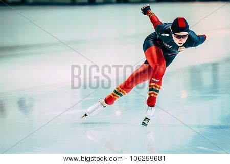 young athlete speed skaters running around the track the rink