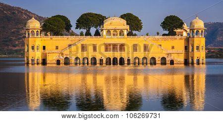 Panorama of Rajasthan landmark - Jal Mahal (Water Palace) on Man Sagar Lake on sunset.  Jaipur, Rajasthan, India