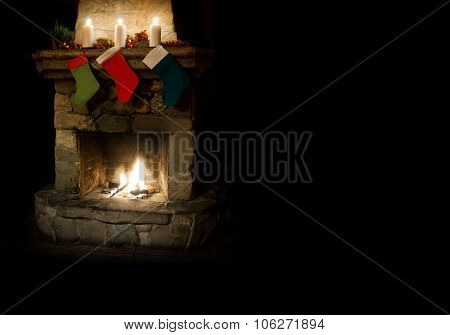 Christmas postcard template. colorful stocking on fireplace background. Chimney place with candles.