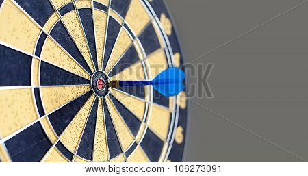 Photography of vintage yellow and black colors darts. Success hitting target aim goal achievement. Blue Dart in bull's eye. copy space. soft focus poster