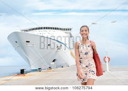 Cruise ship travel going shopping in port on travel cruise vacation at sea. Happy mixed race Asian Chinese Caucasian woman in dress by luxury cruise liner boat.