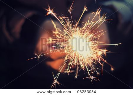 Hands Holding A Burning Sparkler
