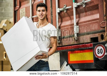 Young Man with Large White Box by Freight Train