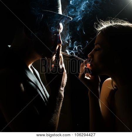 Couple Smoking Cigarettes
