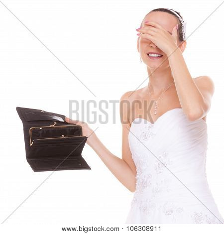Worried bride with empty wallet grabbing her head. Young girl holding purse looking for money cash. Wedding expenses costs expenditure. Finance concept. Woman in white wedding dress isolated on white background. poster