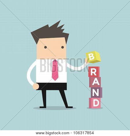 Businessman is building Brand cubic box puzzle