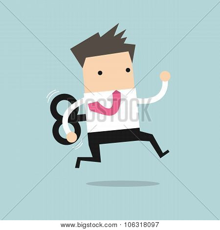 Businessman running with wind-up key