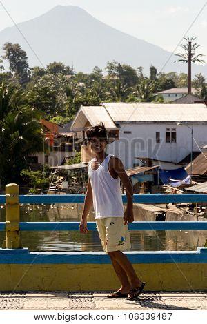 Indonesian Boy In Manado Shantytown