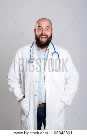 young bearded doctor in white coat looking amazed poster