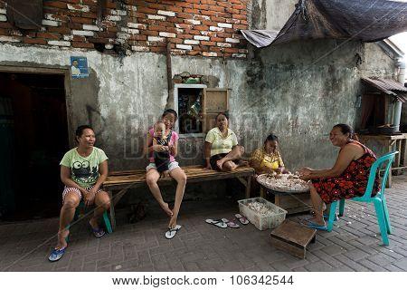 Indonesian Woman Peel Garlic In Manado Shantytown