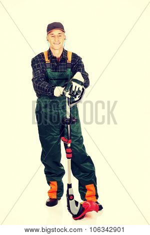 Experienced gardener with trimmer and ear protectors poster