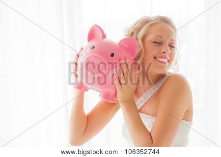 Bride with piggy bank being silly