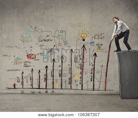 Businessman dealing with graphics