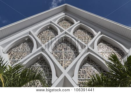 Frontage of white church with inlaid stone mosaic, Florida