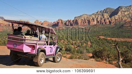A Pink Jeep Tour Descends Broken Arrow Trail