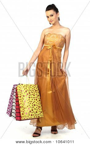 teenage asian girl with shopping bags