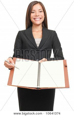 Businesswoman Showing Blank Notebook Copyspace